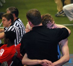 Andrew hugging his coach after his very last wrestling match