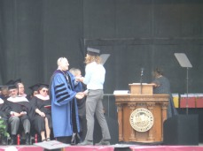Andrew receiving diploma