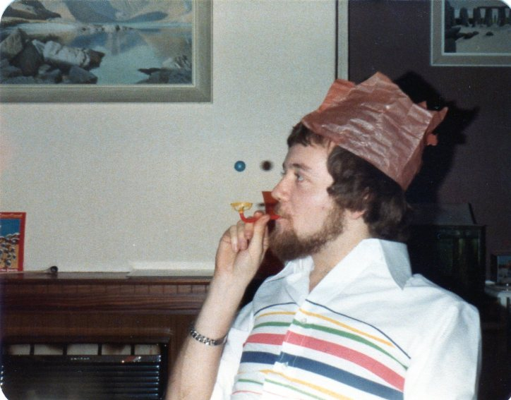 Jeremy with a christmas cracker toy and silly hat